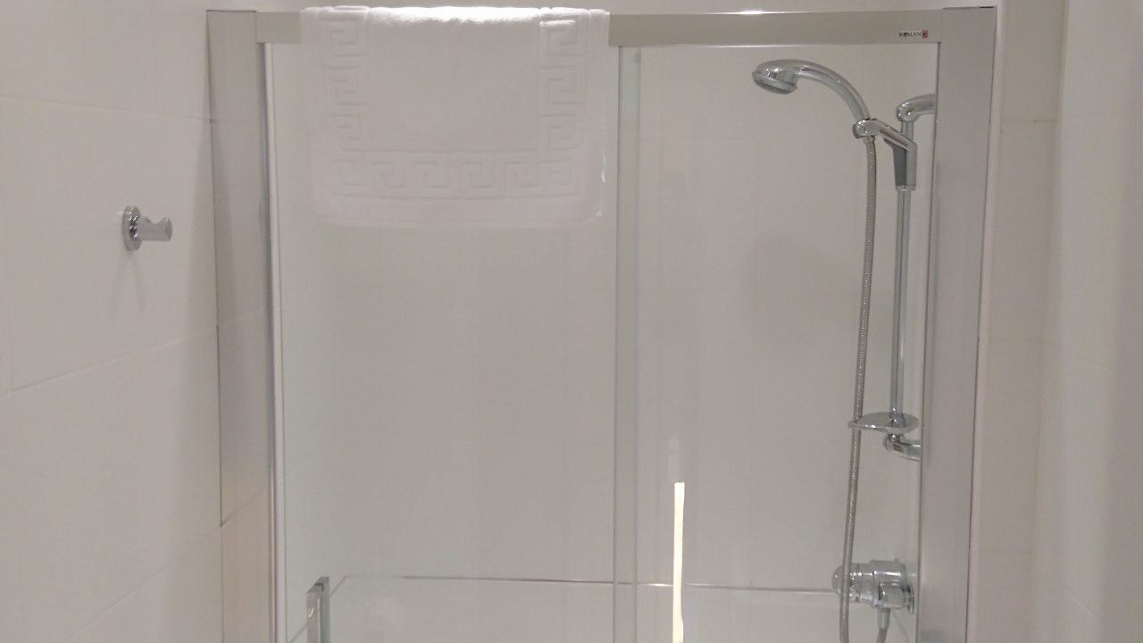 Photograph of one of the ensuite shower rooms with large shower cubicle and complementary toiletries
