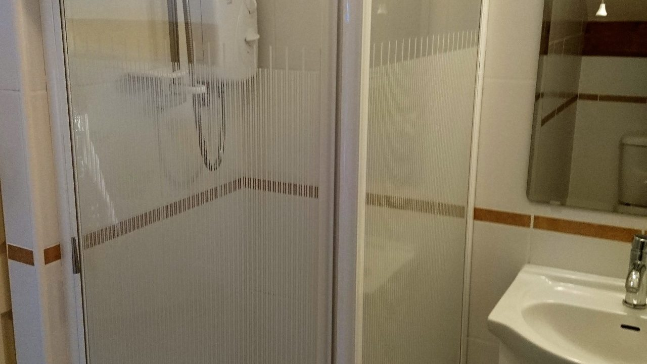 Photograph of one of the ensuite shower rooms with shower cubicle