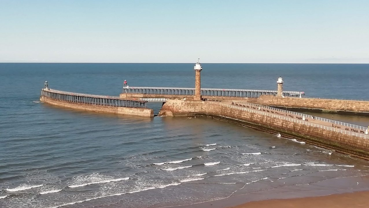 Photograph of the view of the Pier extensions over the beach