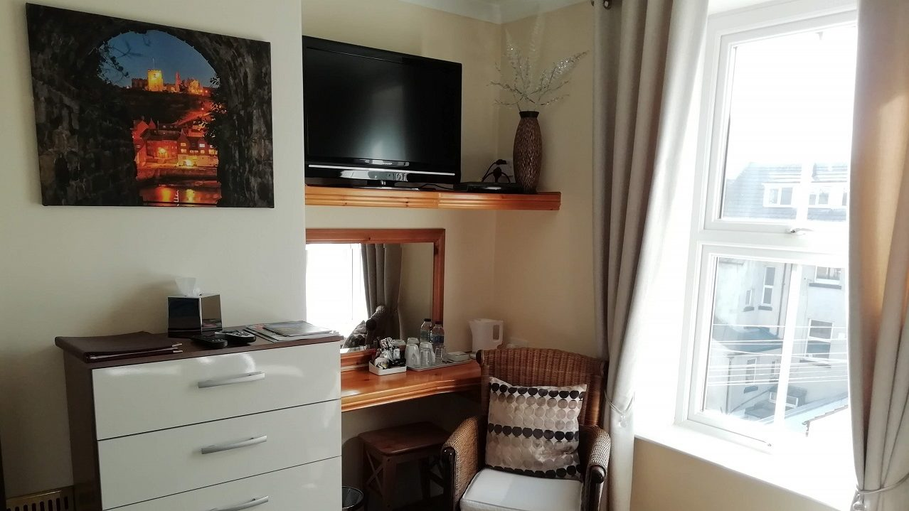 Photograph of Room 1 with vanity mirror, hospitality tray and 32in TV with freesat HD Channels