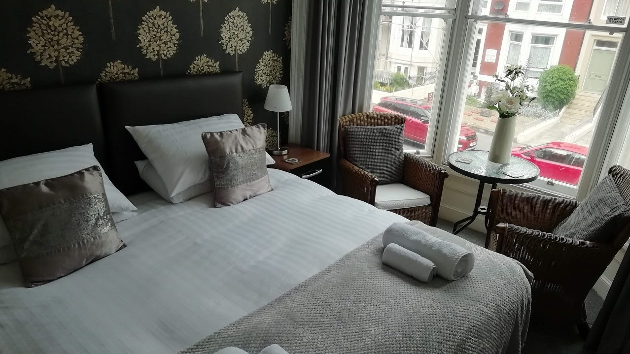 Photograph of Room 2 Super-king room bed and bay window seating