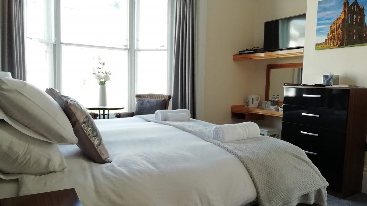 Photograph of Room 2 Super-king room bed with chest of drawers and TV