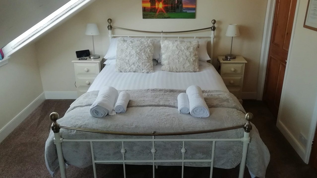 Photograph of Room 8 standard double bed