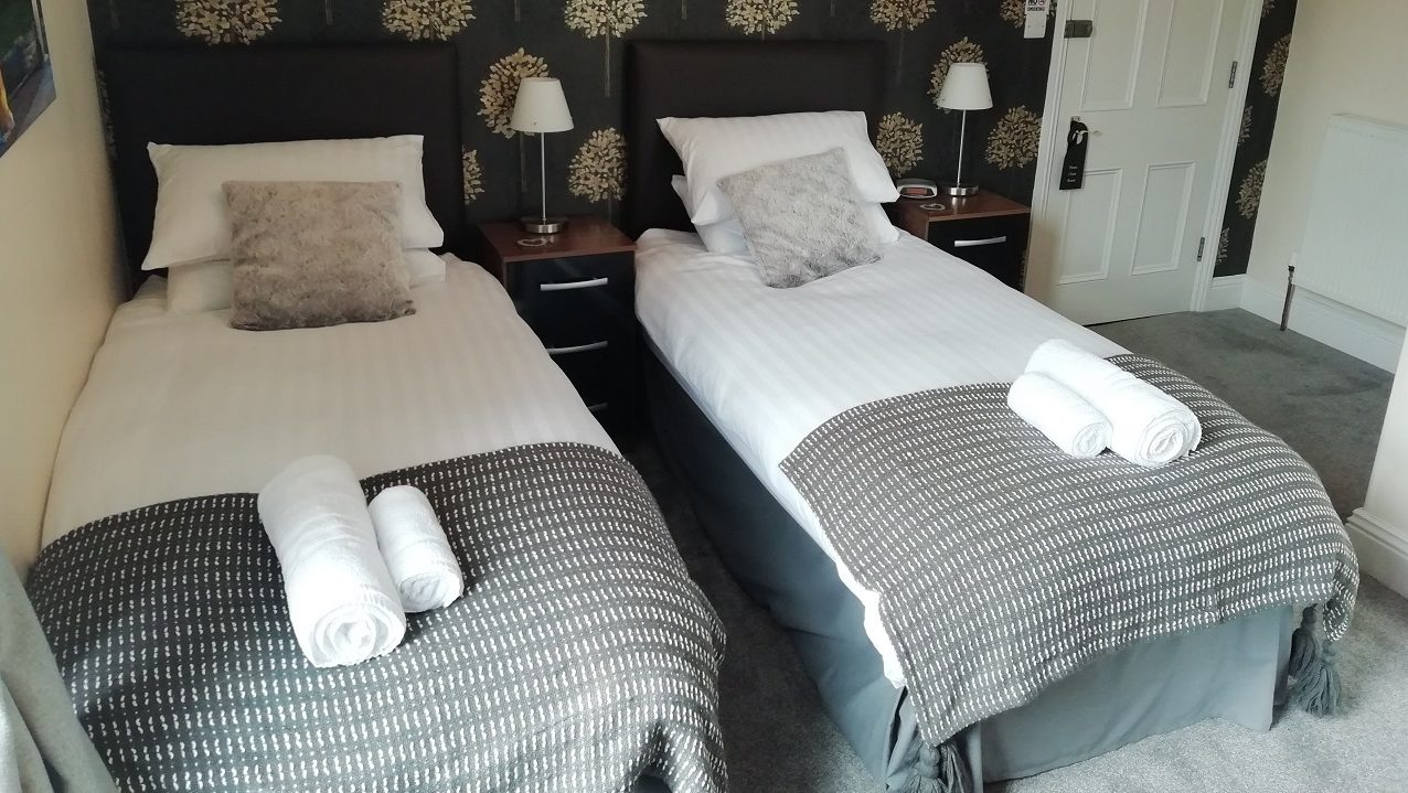 Photograph of Room 1 set up as a twin room - 2 beds with plenty of space